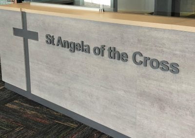 3D acrylic router cut letters for St Angela of The Cross School Reception counter